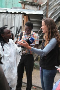 Kenyan journalist recording interview with Theresa Williamson